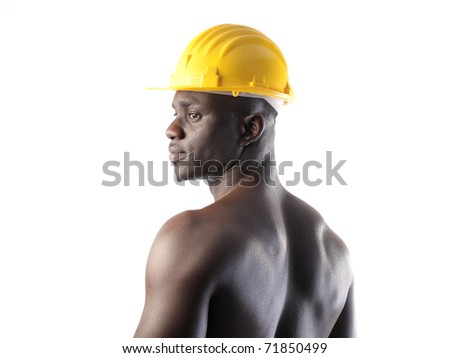 African worker wearing a safety cap - stock photo