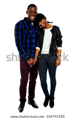 African young couple holding hands. Woman with her head on mans shoulder