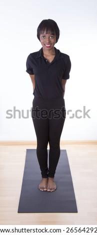 African young girl doing yoga - stock photo