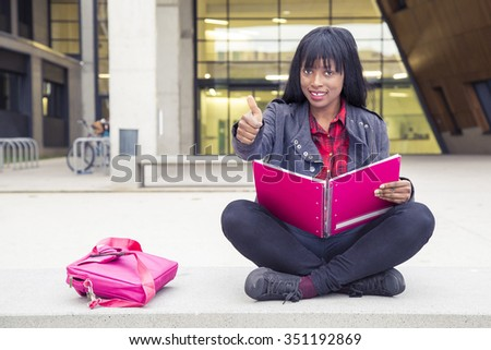 African Young girl studying with book