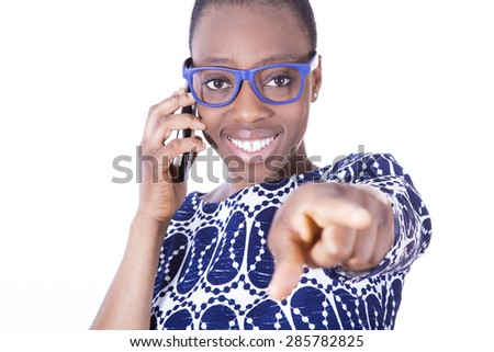 African young girl talking on mobile phone - stock photo