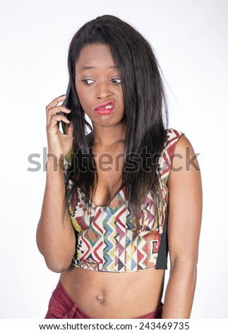 African young girl talking on smart phone - stock photo