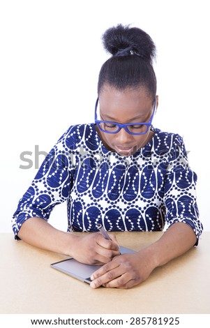 African young girl working with an electronic tablet - stock photo