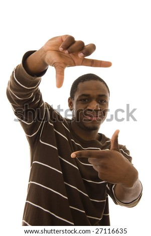 African young man doing a frame with his hand (focus on the eyes) - stock photo