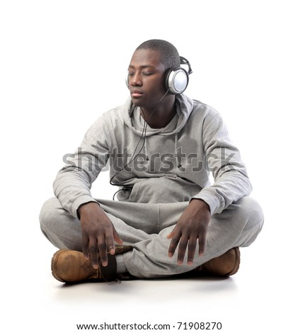 African young man listening to music - stock photo