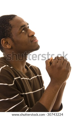 African young man praying isolated on white - stock photo