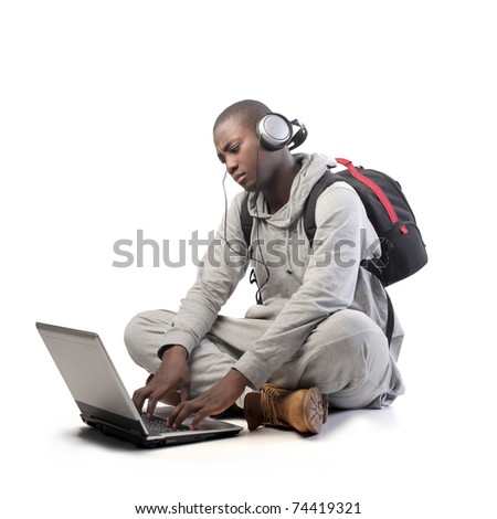 African young man using a laptop - stock photo