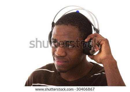 african young men enjoying some music in the headphones (isolated on white)