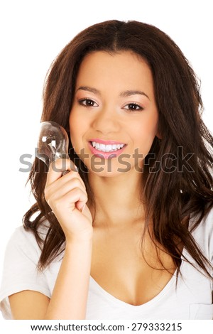 African young woman with light bulb. - stock photo