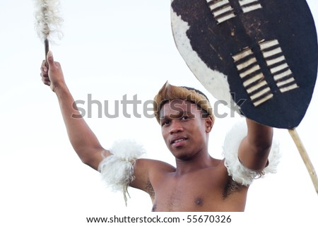 african zulu man holding traditional shield - stock photo