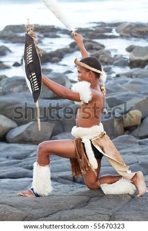 african zulu man on beach - stock photo