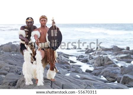 african zulu man posing on beach - stock photo