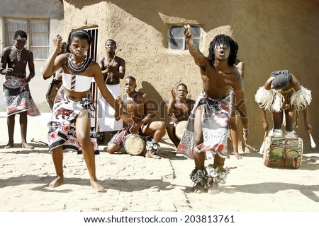 Africans dancing in a local village in Port Elizabeth, South Africa dancing and playing for tourists 11 April 2014 - stock photo