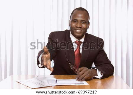 Africsn american businessman stretching his arm - stock photo