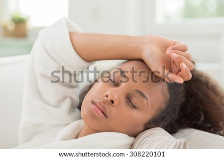 Afro-American beauty girl sleeping during the day - stock photo