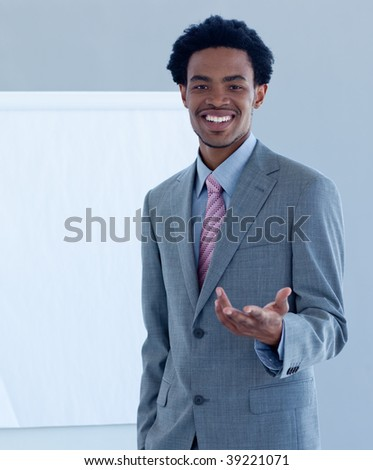 Afro-American businessman introducing stock market to his team - stock photo