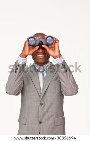 Afro-American businessman looking through binoculars against white - stock photo