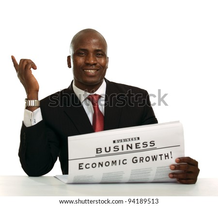 Afro-American businessman reading a newspaper , isolated on white background