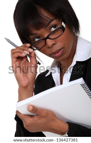 Afro-American businesswoman holding a notepad - stock photo