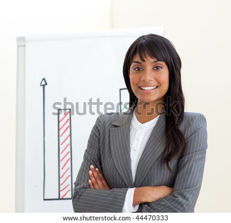 Afro-american businesswoman with folded arms in front of a board against a white background - stock photo
