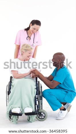 Afro-American doctor talking to a senior patient in a wheel chair - stock photo