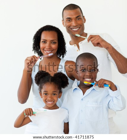 Afro-american family brushing their teeth in the bathroom - stock photo