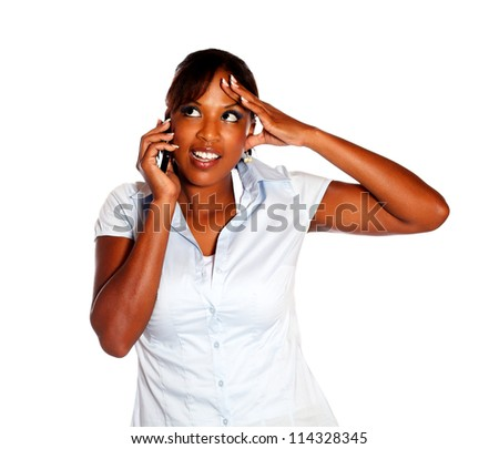 Afro-american female speaking on cellphone on isolated background