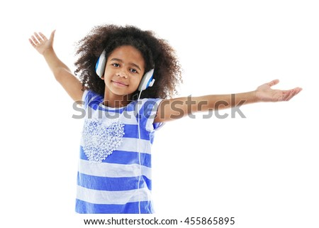 Afro-American little girl with headphones isolated on white
