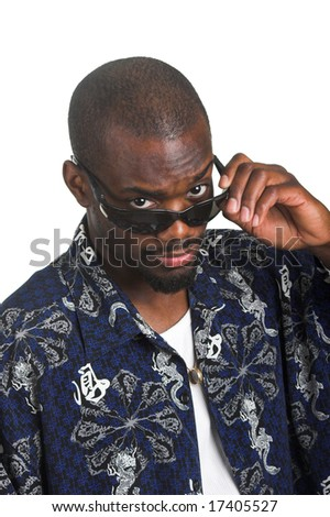 Afro-American man looking over sunglasses. - stock photo