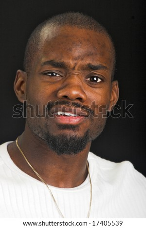 Afro-American man with a very confused expression. - stock photo