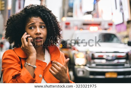 afro american woman calling 911 in New york city. concept about car accidents and emergency - stock photo