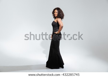 Afro american woman in fashion dress posing isolated on a white background - stock photo