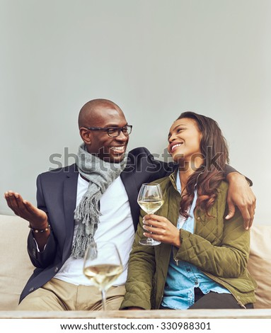 Afro american woman in love looking at her husband - stock photo