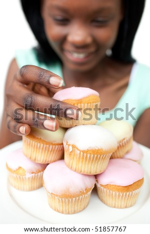 Afro-american woman taking a cake against a white background - stock photo