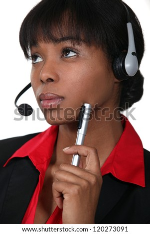 Afro-American woman wearing a headset - stock photo