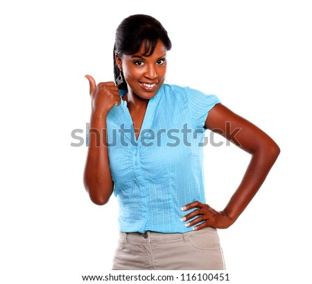 Afro-american woman with a winning attitude on blue shirt on isolate background - stock photo