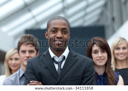 Afro-American young businessman leading his team - stock photo