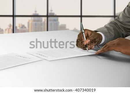 Afro businessman's hand signs contract. Man signing contract in town. He agreed to the proposition. Good salary and nice perspective. - stock photo