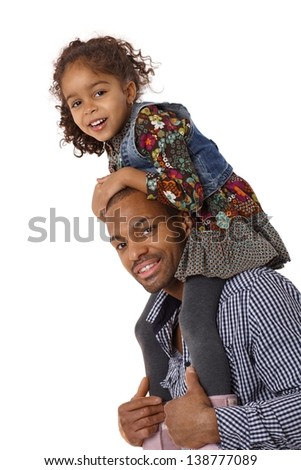 Afro father giving little daughter a shoulder ride, both smiling. - stock photo