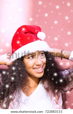 afro girl with santa hat
