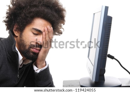 Afro man and his computer - stock photo