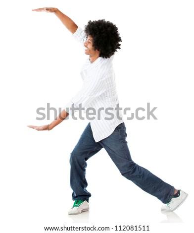 Afro man holding something imaginary - isolated over a white background - stock photo