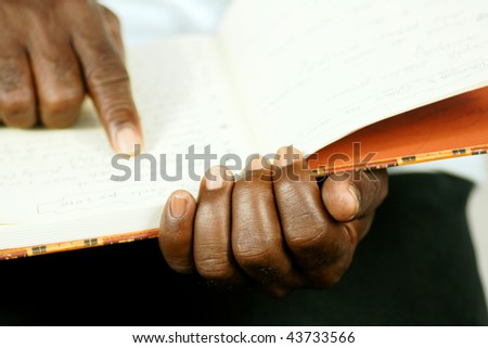 afro man reading his journal - stock photo
