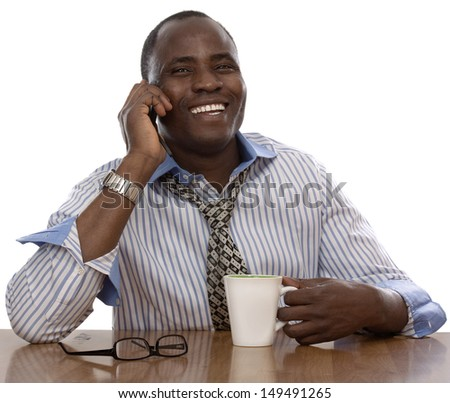 Afro man sitting on the desk and talking on the phone, isolated on white background - stock photo