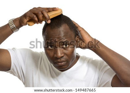 Afro man with comb, isolated on white background