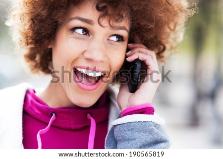 Afro woman with mobile phone  - stock photo