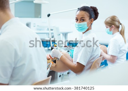Afroamerican dentistry student in medical mask during classes