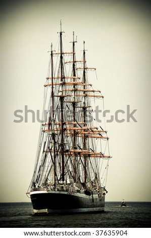 Aft of the sailboat leaving to the open sea - stock photo