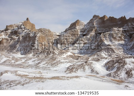 After a fresh snowfall, a Winter Mountain Scene in Badlands park. Red rock and snow.