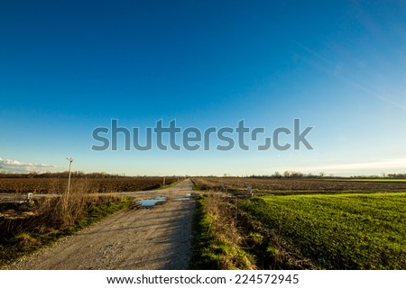 after a shower big puddles in a country road - stock photo